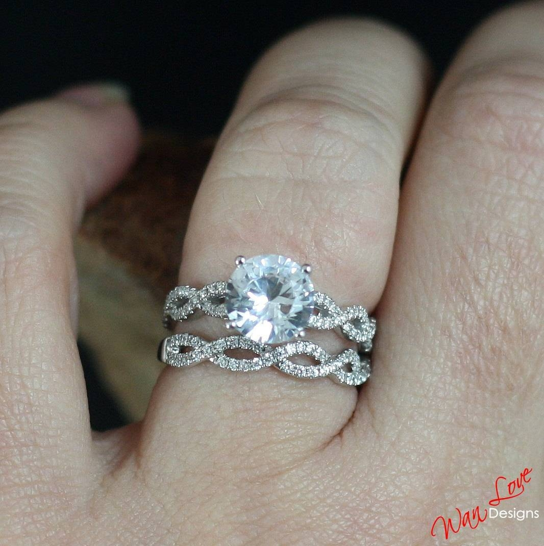 Forever One Moissanite & Diamond Infinity Twist Round Throughout Infinity Twist Wedding Bands (View 14 of 15)