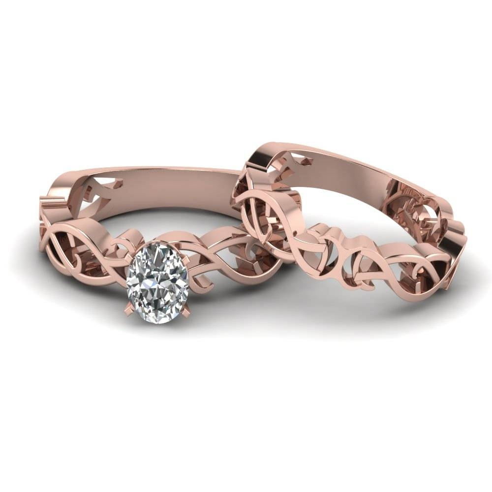 Oval Shaped Diamond Intricate Grid Solitaire Wedding Set In 14k Inside Rose Gold Wedding Bands Sets (View 7 of 15)