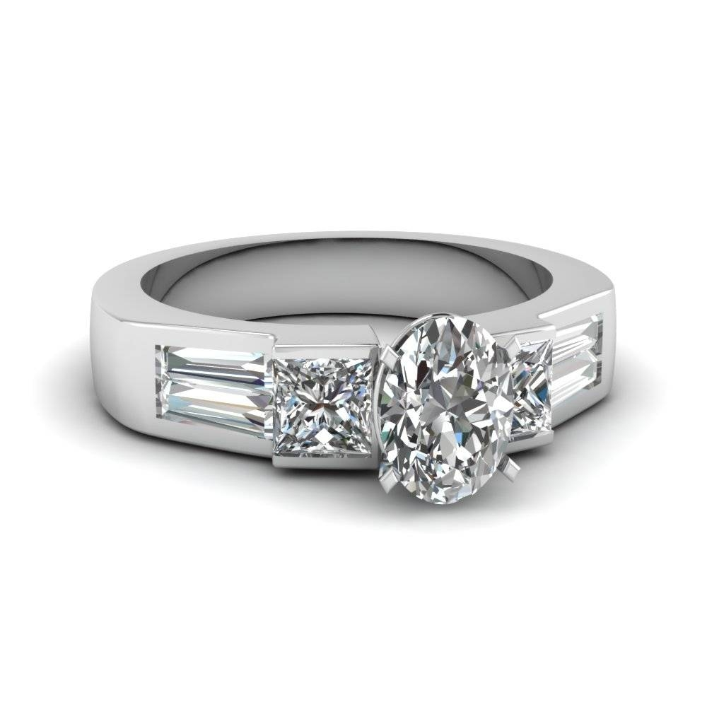 Platinum Oval Shaped Tapered Baguette Side Stone Engagement Rings With Preset Engagement Rings (View 8 of 15)