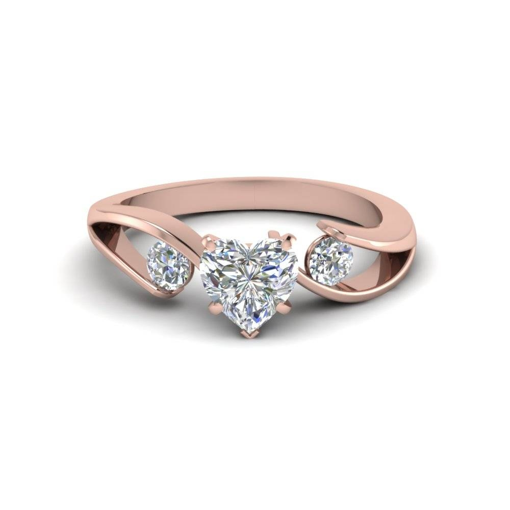Tension Set Heart Shaped 3 Stone Diamond Ring In 18k Rose Gold Throughout Heart Engagement Rings (View 12 of 15)
