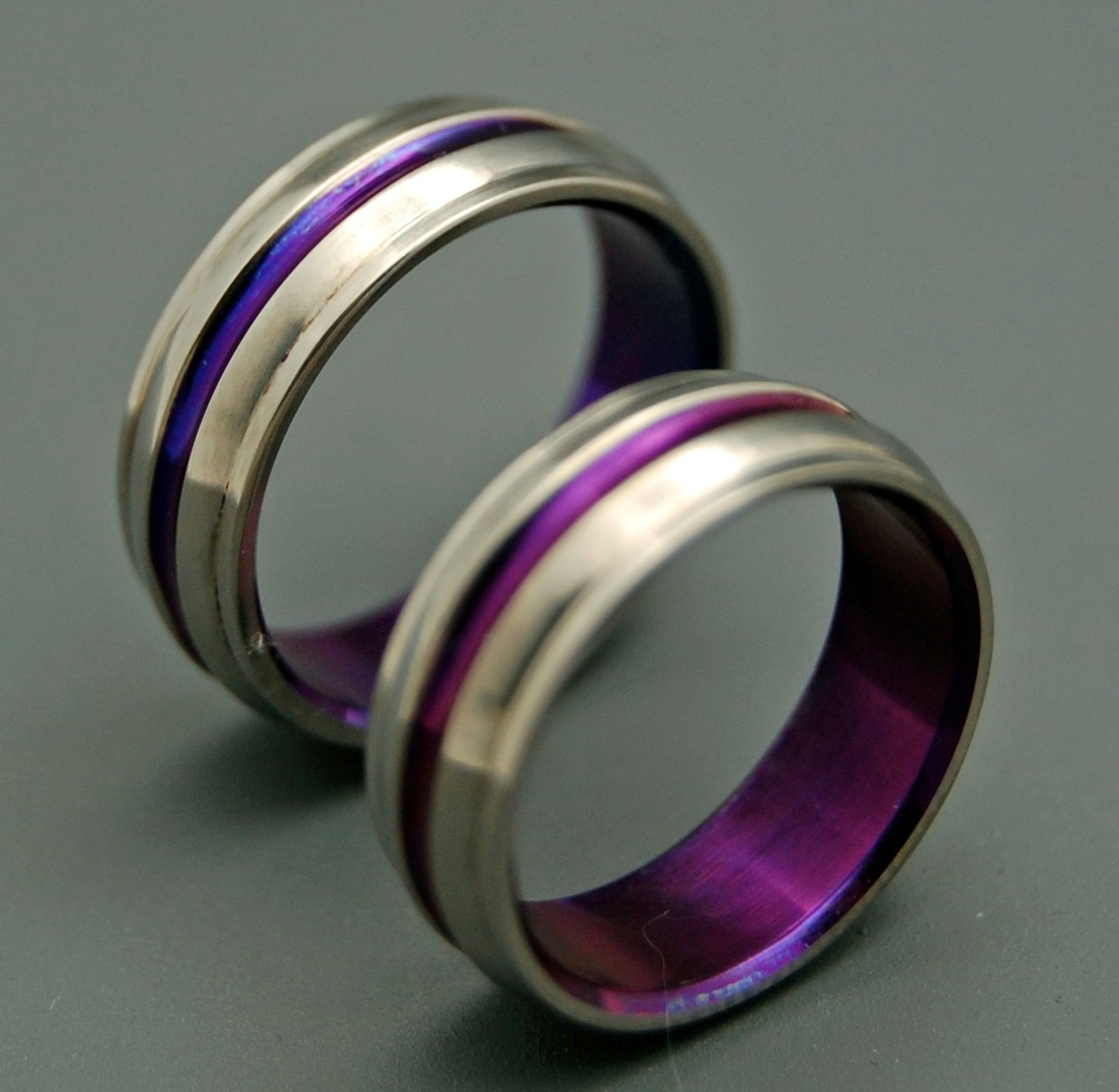 Purple wedding bands are ideal choices so that they can enhance your wedding rings more attractive.