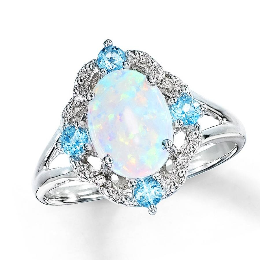 Wedding Rings Ideas: Diamond White Three Stones Centerpieces Opal Within Blue Opal Wedding Rings (View 14 of 15)