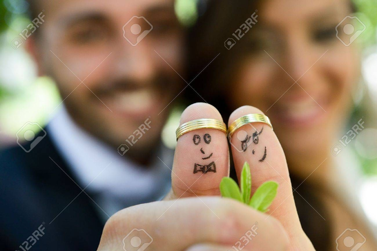 Wedding Rings On Their Fingers Painted With The Bride And Groom Within Fun Wedding Rings (View 15 of 15)