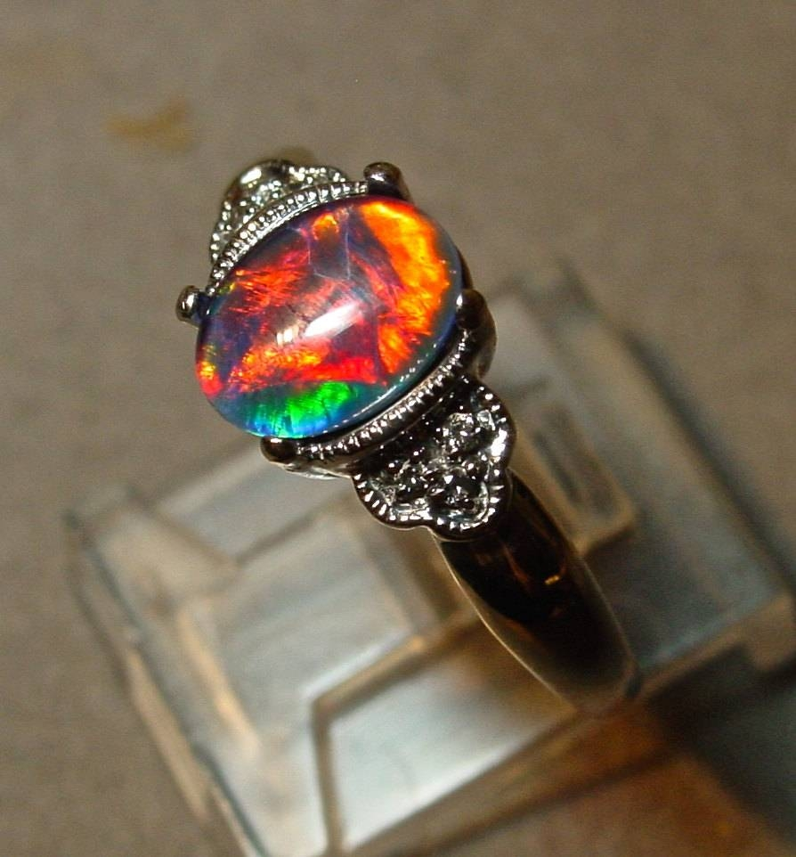 Antique Style Opal Engagement Ring With Diamond Accents (View 3 of 15)