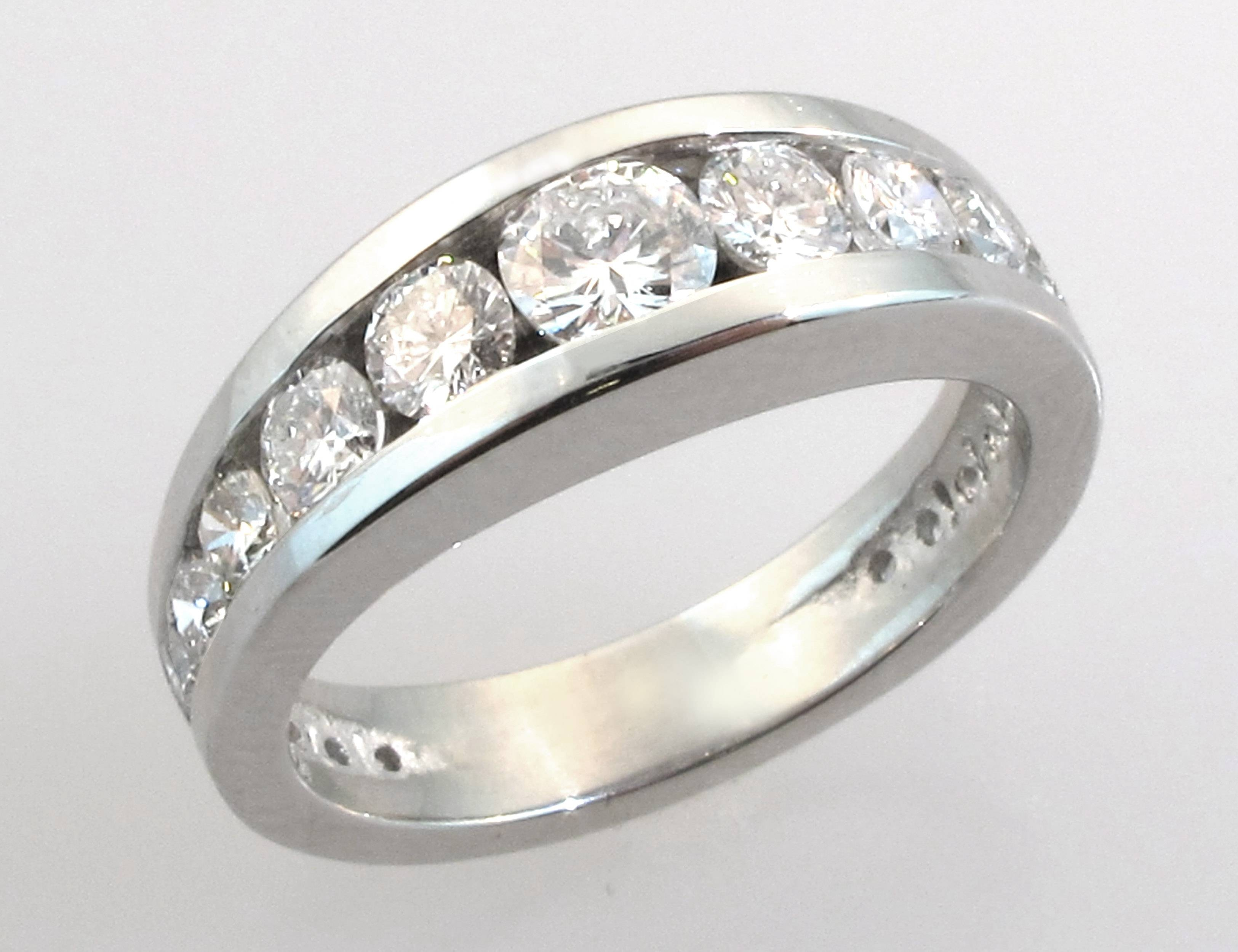 Embedded Centre Stone Tapered Side Stones Engagement Ring Inside Embedded Diamond Engagement Rings (Gallery 7 of 15)