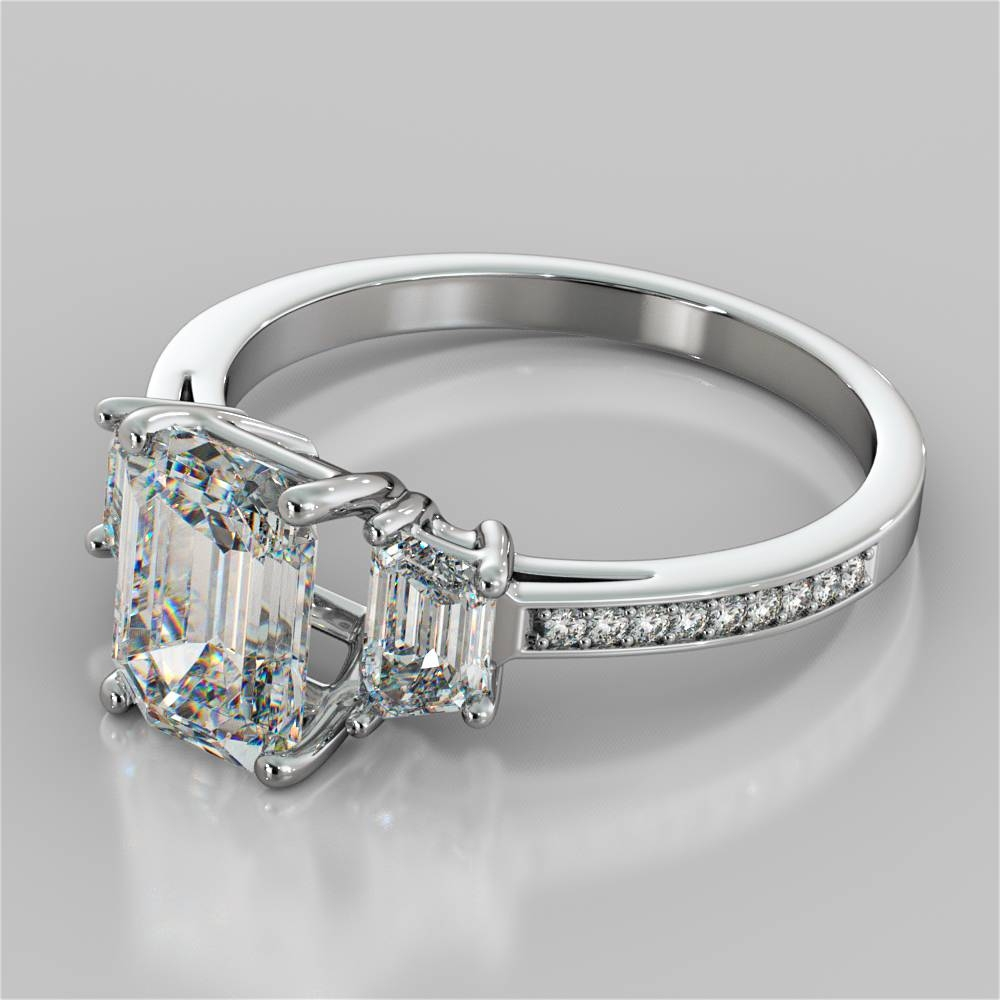 Emerald Cut Three Stone Engagement Ring With Trapezoid Accents Throughout Emerald Cut Three Stone Diamond Engagement Rings (View 11 of 15)