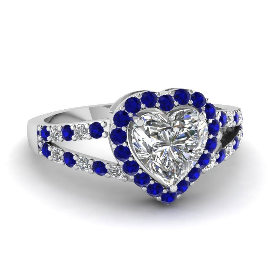 Heart Shaped Halo Diamond Split Shank Ring With Blue Sapphire In Regarding Blue Heart Engagement Rings (Gallery 4 of 15)