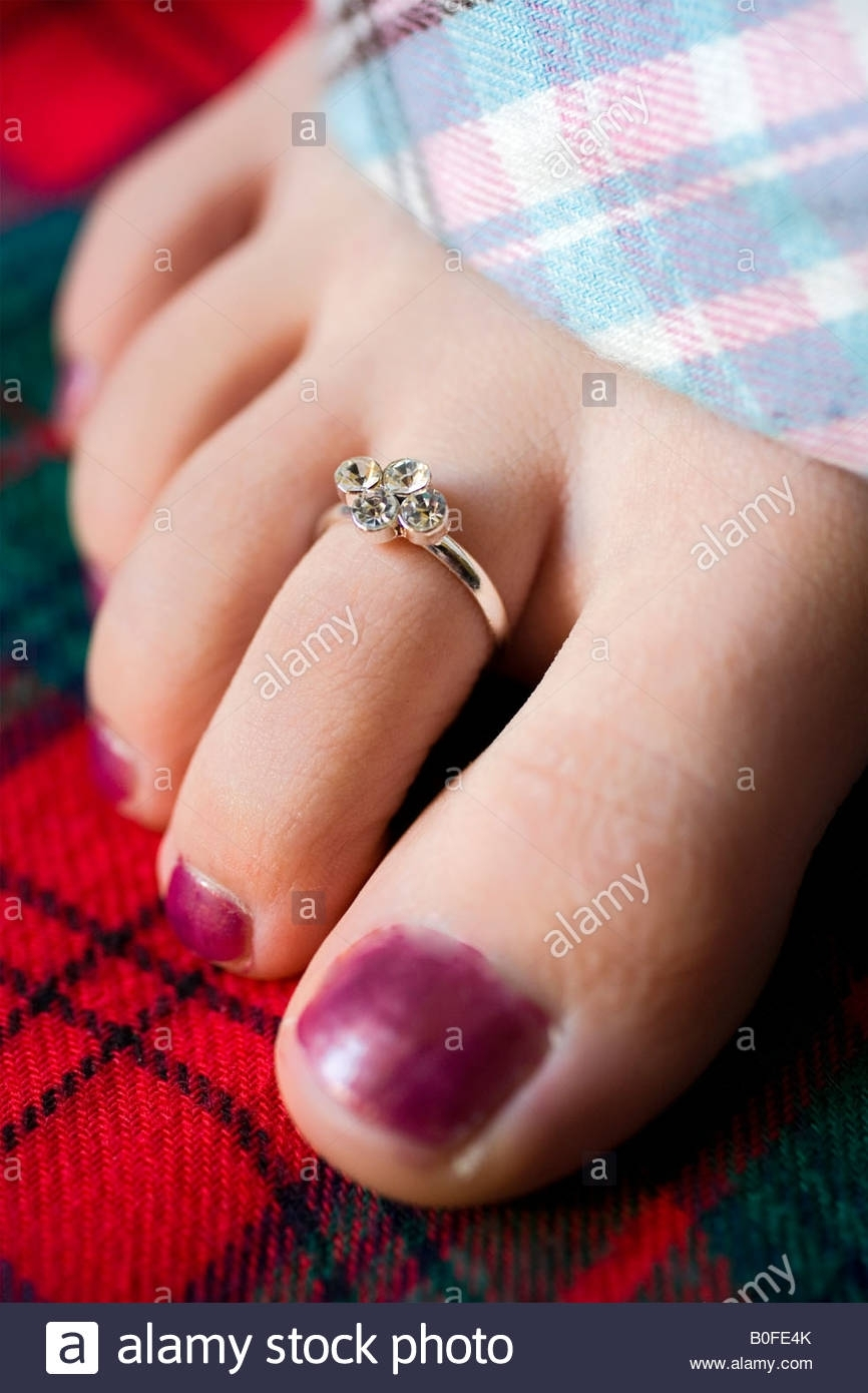 A Closeup Of A Young Female Teenager's Foot Wearing A Toe Ring And Regarding Current Toe Engagement Rings (View 3 of 15)