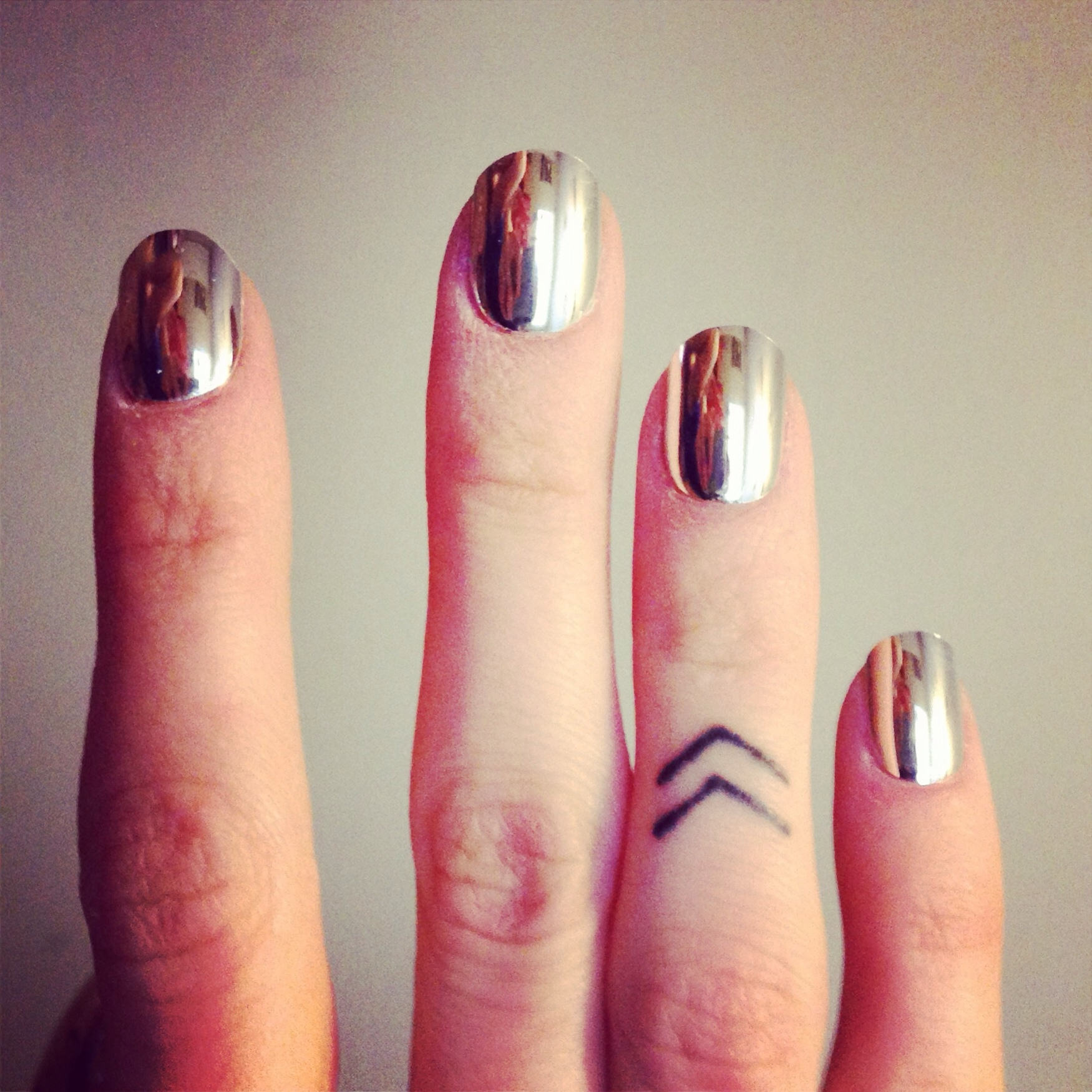 Double Chevron Ring Finger Tattoo And Chrome Mirror Nails Throughout Recent Chevron Finger Rings (View 7 of 15)