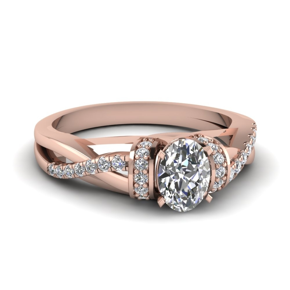 Pave Twisted Oval Shaped Diamond Engagement Ring In 14K Rose Gold Inside Most Popular Baguette Diamond Twist Wedding Bands (View 10 of 15)