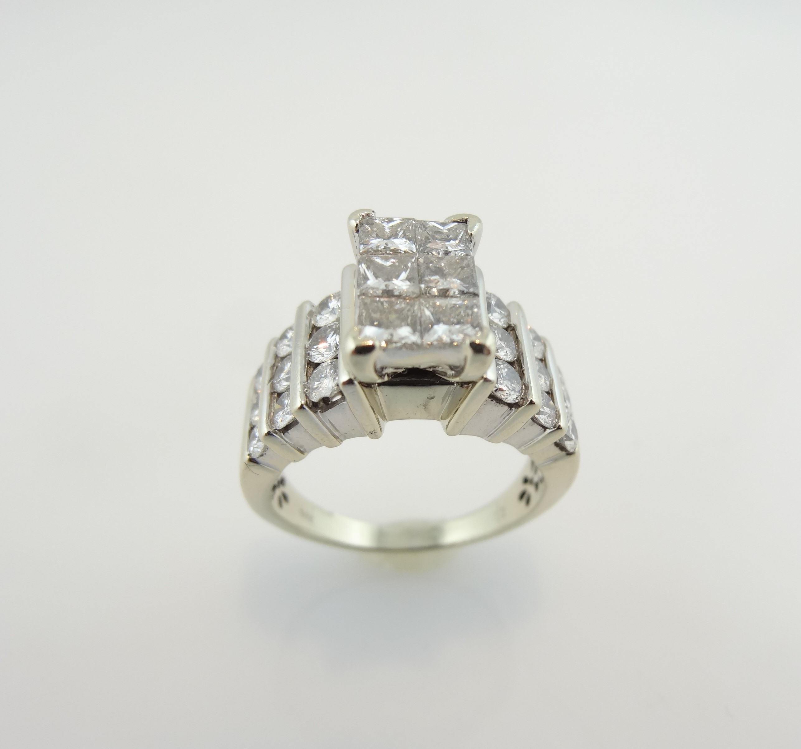 6 Princess Cuts, Invisibly Set For The Center Of This Engagement Ring In  White Gold Intended For Most Current Princess Cut And Round Diamond Three Row Anniversary Bands In White Gold (View 6 of 25)