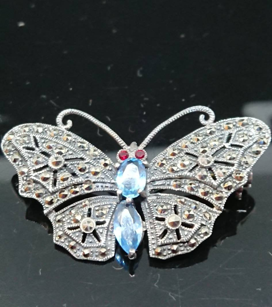 925 Marcasite, Blue Topaz, Garnet Butterfly Brooch Inside 2019 Blue Pavé Butterfly Brooch Necklaces (View 4 of 25)