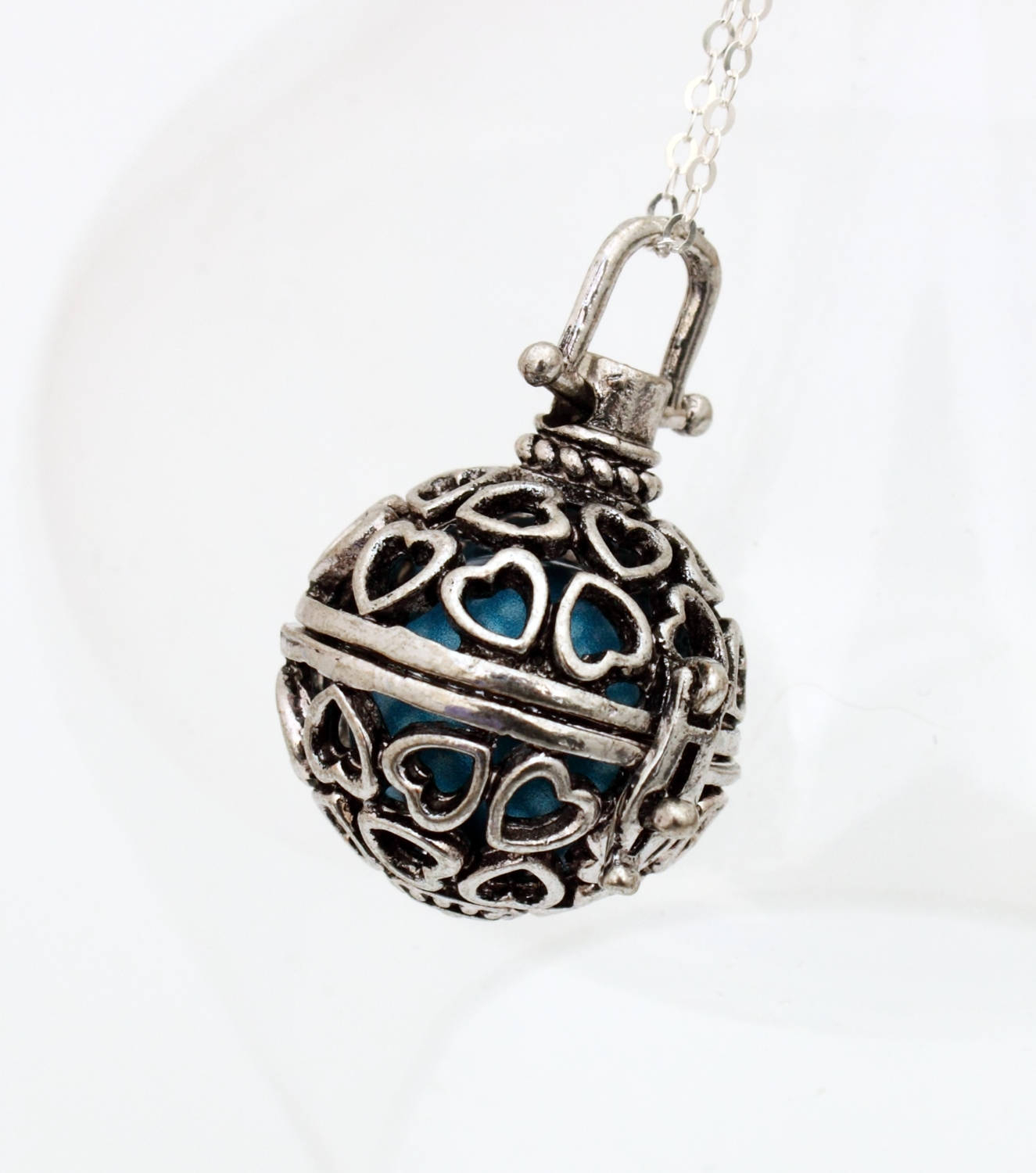 Angel Caller Filigree Heart Locket With Choice Of Coloured Chime Ball Harmony Bell Pregnancy Necklace Mexican Bola Necklace Silver Plate Pertaining To Current Chiming Filigree Hearts Pendant Necklaces (View 25 of 25)