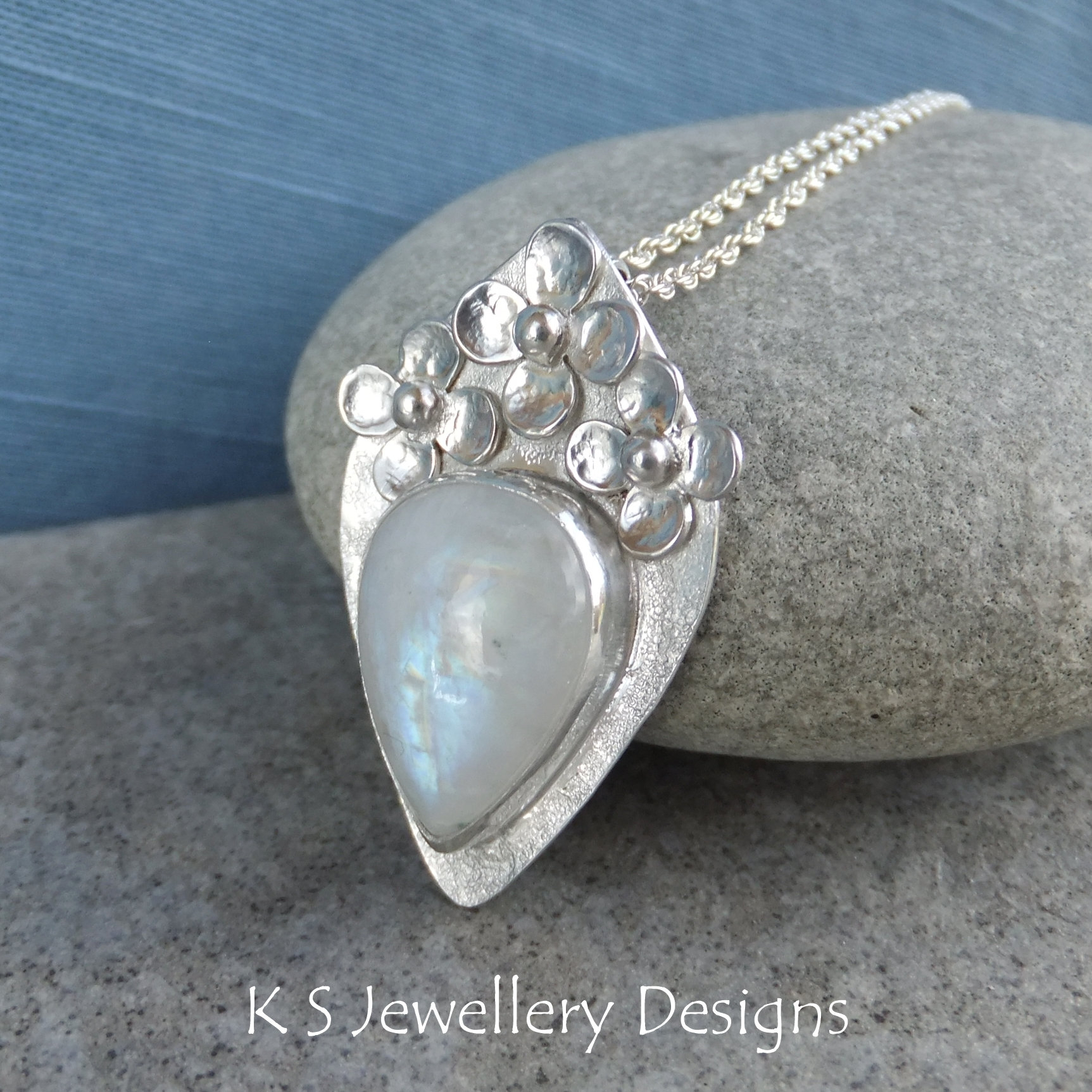 Rainbow Moonstone Flower Adorned Sterling Silver Drop Pendant – Four Petal Flowers – Handmade Metalwork Gemstone Necklace Jewellery For Most Current Four Petal Flower Necklaces (View 14 of 25)