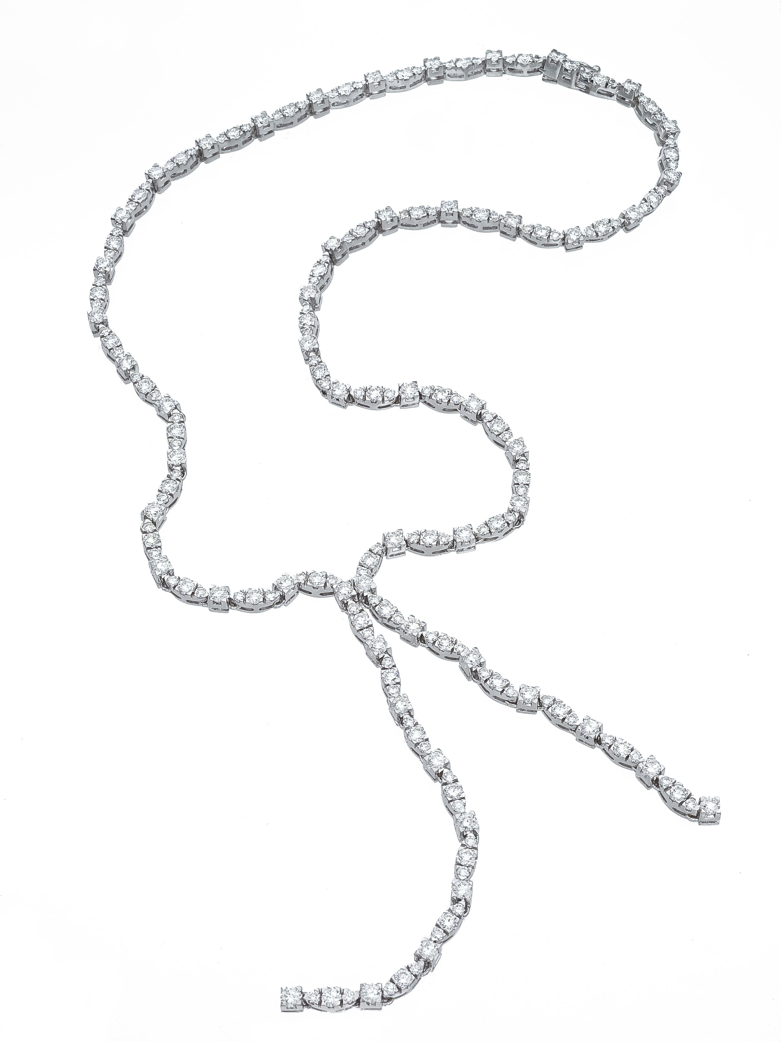 An 18K White Gold Diamond Lariat Necklace Containing (View 11 of 25)