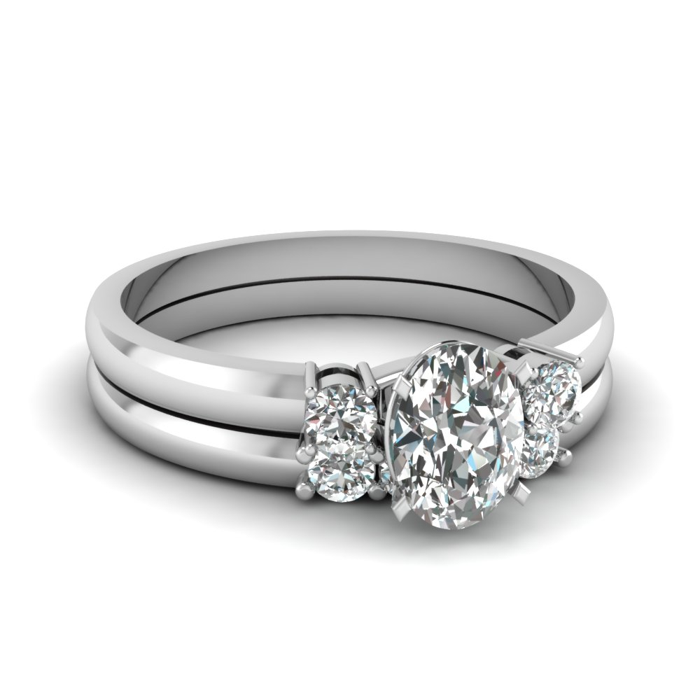 Basket Prong 3 Stone Wedding Set Regarding Most Up To Date Prong Set Oval Shaped Diamond Wedding Bands (Gallery 7 of 25)
