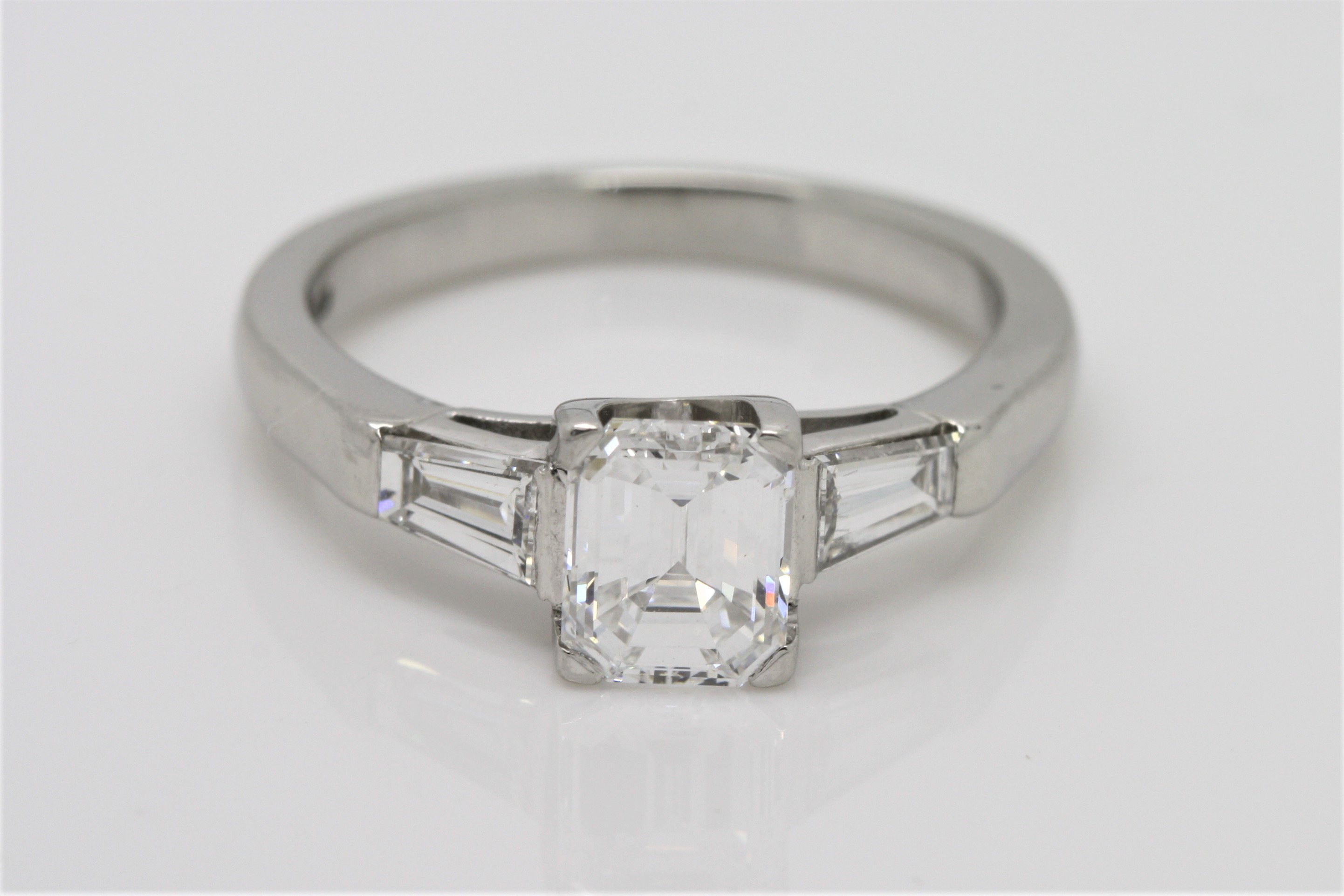 Emerald Cut Diamond Solitaire With Diamond Tapered Baguette Side Stones In Platinum Ring Inside Emerald Cut Engagement Rings With Tapered Baguette Side Stones (View 7 of 25)