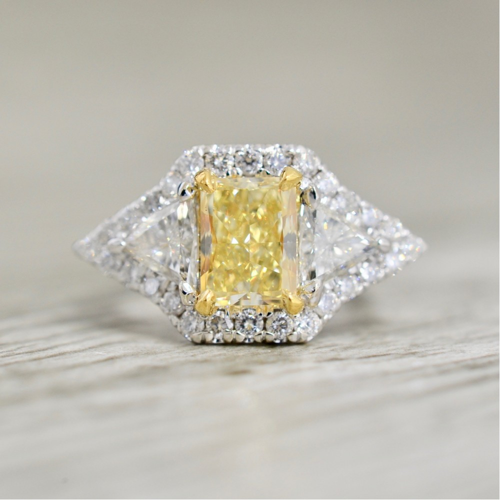 Fancy Yellow Radiant Diamond Flankedtrillions In A Three Stone Halo Engagement Ring In White With Radiant Yellow Diamond Rings (View 7 of 25)