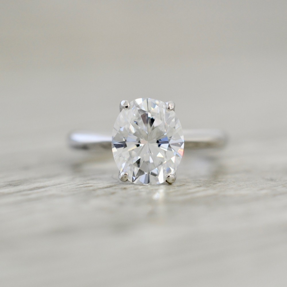Oval Cut Diamond In A Knife Edge Solitaire Engagement Ring In White Intended For Oval Shaped Diamond Micropavé Engagement Rings (Gallery 24 of 25)