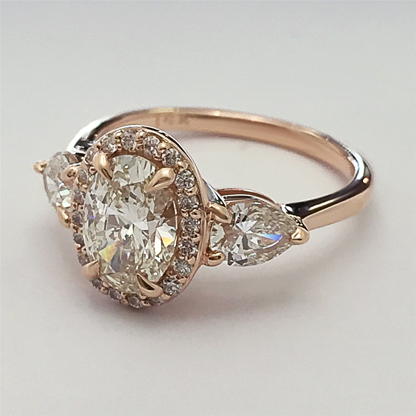 Oval Shaped Diamond Engagement Ring With Pear Shaped Diamonds On The Side Throughout Oval Shaped Engagement Rings (View 12 of 25)