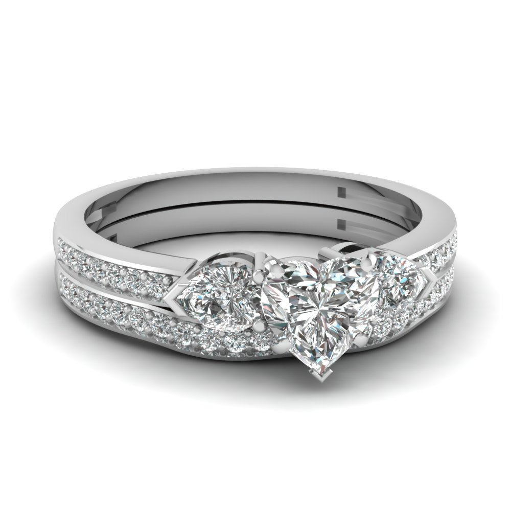 Pear Accent 3 Stone Bridal Set Within Most Current Prong Set Heart Shaped Diamond Wedding Bands (View 24 of 25)