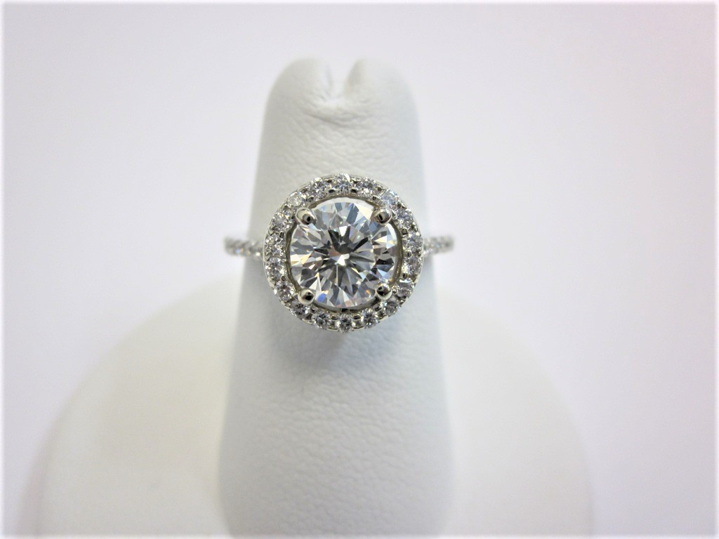 Round Brilliant Cut Halo Diamond Engagement Ring (View 11 of 25)
