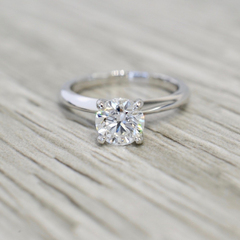 Round Brilliant In A Four Prong Knife Edge Solitaire Engagement Ring In White Within Solitaire Round Brilliant Engagement Rings (View 17 of 25)