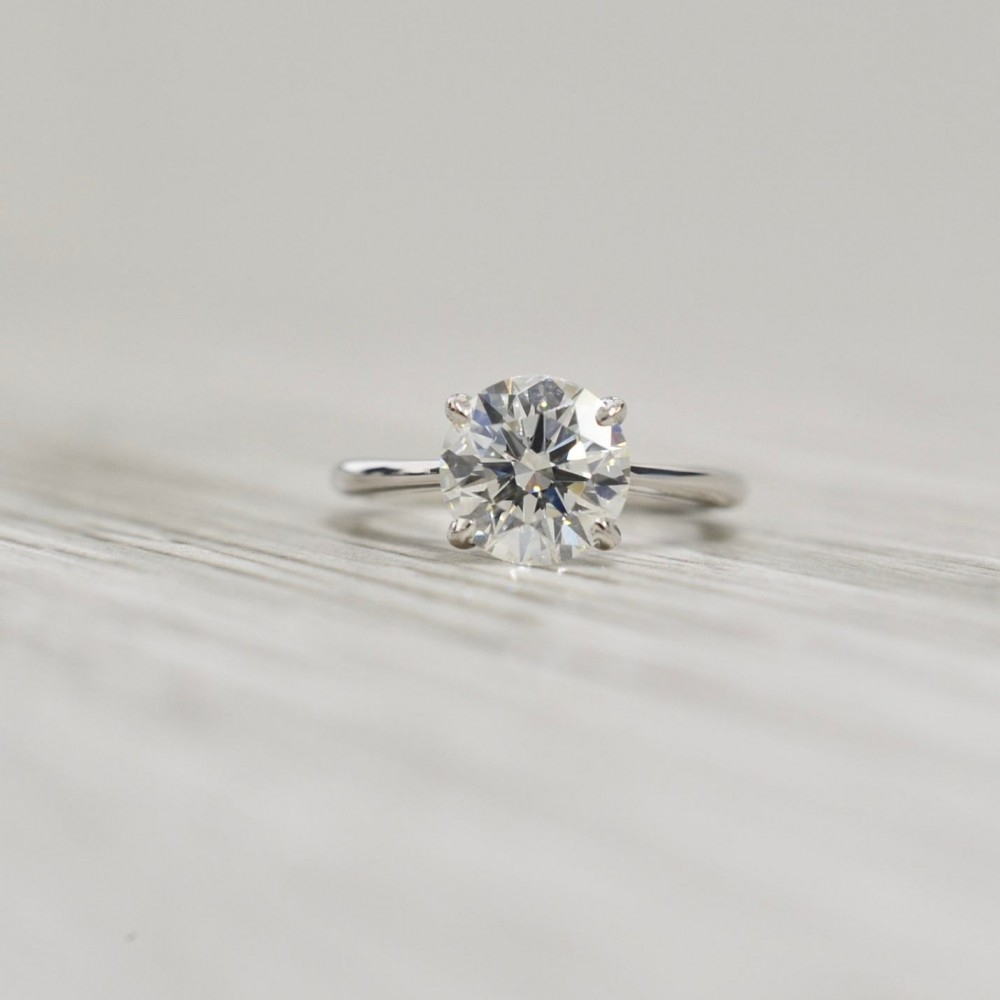 Round Brilliant In A Four Prong Petite Dome Tapered Open Cathedral Solitaire Engagement Ring In White With Solitaire Round Brilliant Engagement Rings (View 5 of 25)