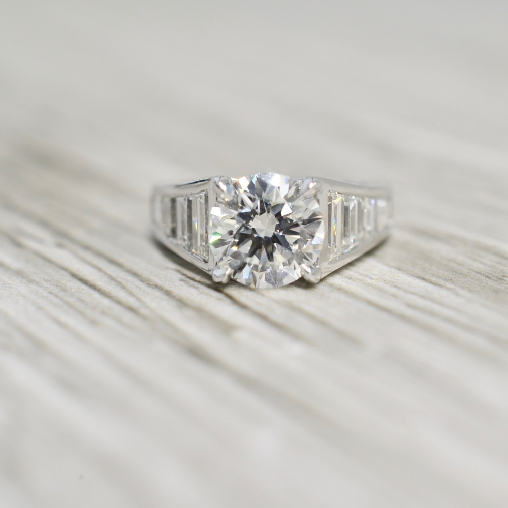 Round Brilliant In A Step Cut Trapezoid Tapered Baguette Channel Set  Engagement Ring In White Throughout Most Popular Channel Set Round Brilliant And Baguette Cut Diamond Wedding Bands (View 25 of 25)