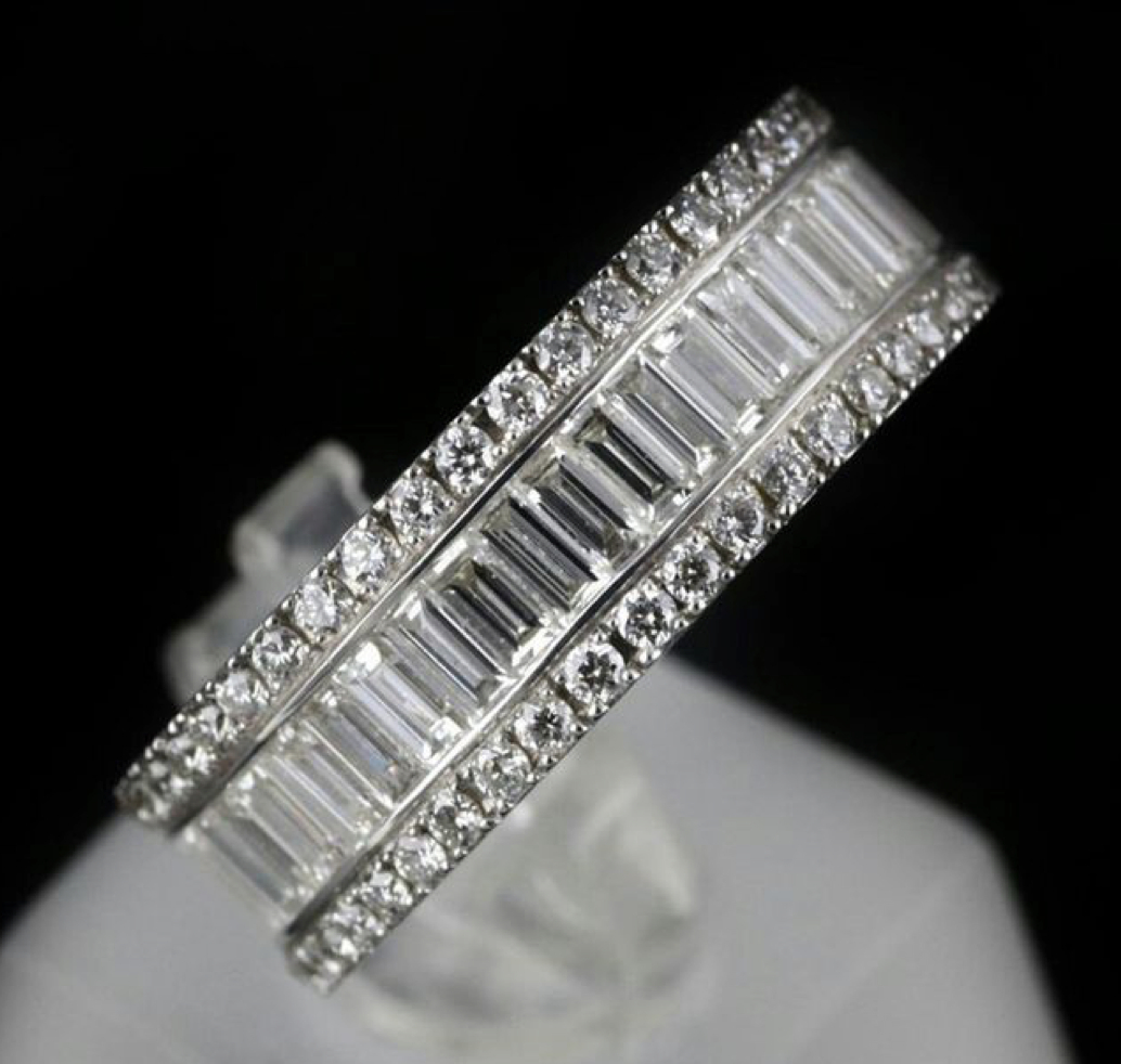 Vertical Baguettes In Between Two Rows Of Round Brilliant Regarding Most Recently Released Vertical Diamond Row Wedding Bands (View 9 of 25)