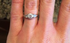 Round Brilliant Engagement Rings With Pear-Shaped Side Stones
